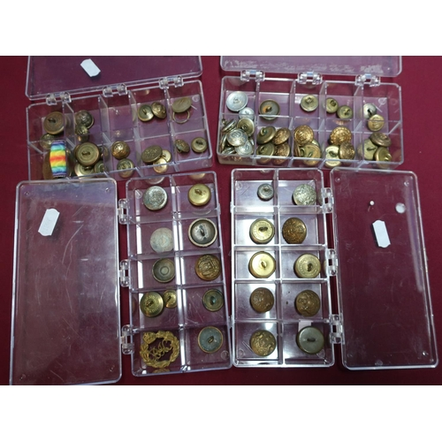 114 - Four cases of various assorted military and other buttons including Victorian and later, various reg...