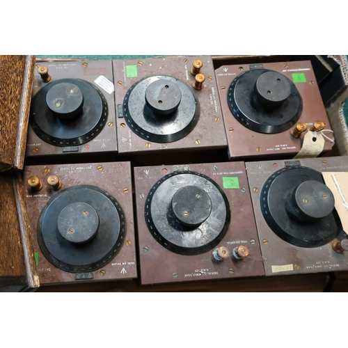 124 - Eight various military condenser variable X6F units with broad arrow marks in wooden casings...
