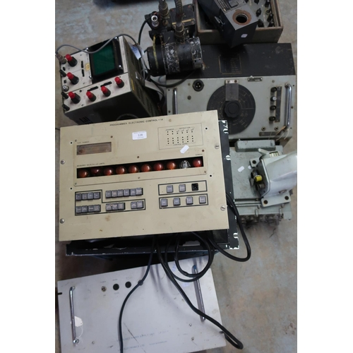 128 - Large selection of mid to late 20th C military electronics, including programmer electric control un...
