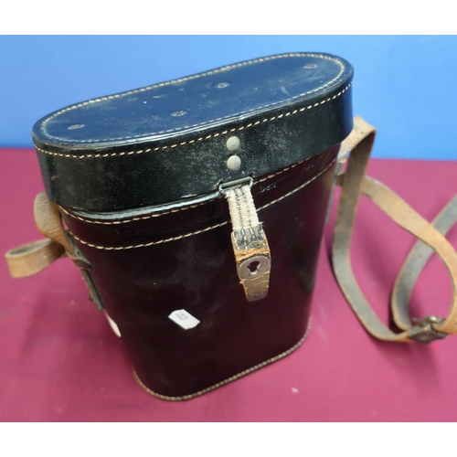 130 - WWII period German Third Reich black leather Marine binocular case, the top stamped with impressed m...