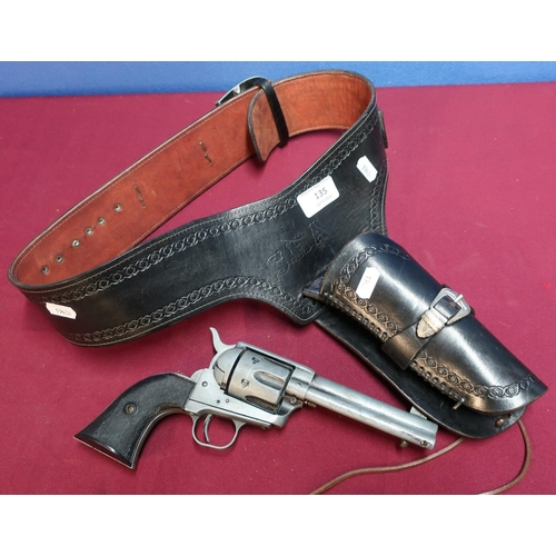 135 - Tooled leather Western style gun holster belt with a replica model single Action Army .45 1874 revol...
