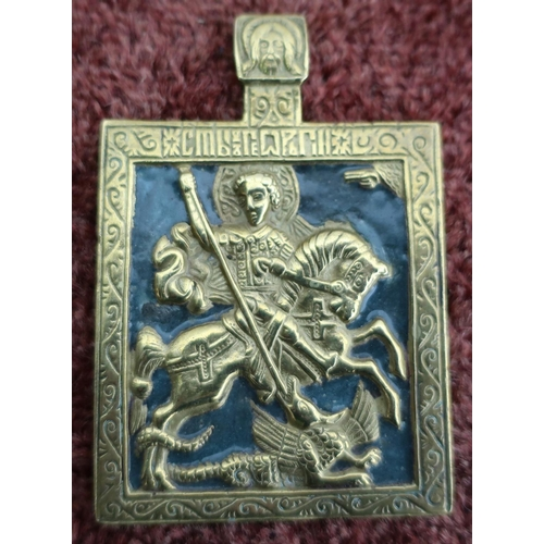 35 - Brass and enamel Russian icon depicting Saint George and the dragon (5.2cm x 7.5cm)...