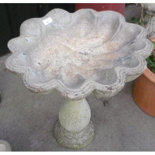 87 - Birdbath in the shape of a shell on a plinth...