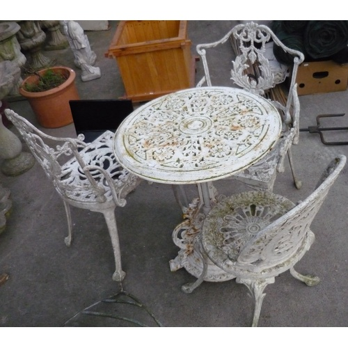 88 - Outdoor garden table with two carvers and a single chair...