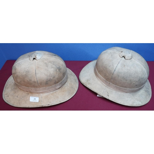 29 - British military issue pith helmet complete with leather liner and chin strap, the liner stamped 6 7...