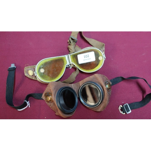 102 - Pair of c.WWII Air Ministry red tinted goggles and a pair of dispatch style riders yellow tinted gog...