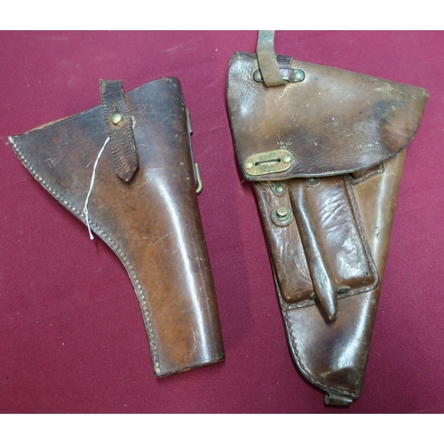 136 - Swedish leather pistol holster and a 1916 leather Webley service revolver holster marked NGR.1916 (2...