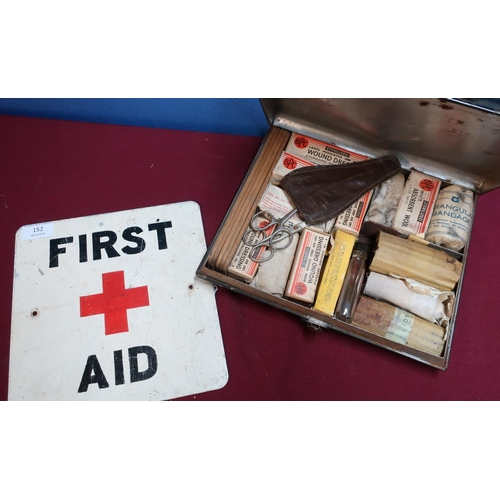 152 - Alloy First Aid post sign and a early to mid 20th C paragon First Aid japped metal tin cased kit (2)...