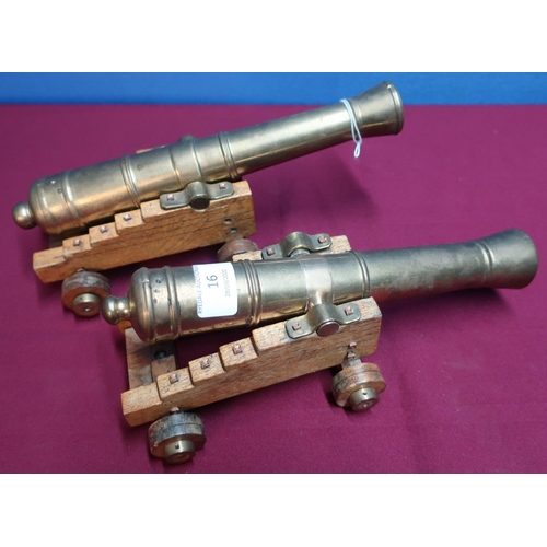 16 - Pair of quality bronze cannon models with 11 inch staged barrels on oak carriages...