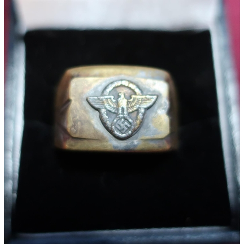 169 - A German third reich brass signet ring with inset eagle above swastika...