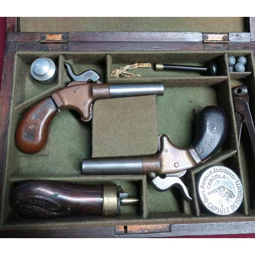 2 - Cased pair of percussion cap Derringer type pistols with 2 inch turn off barrels, brass actions and ...