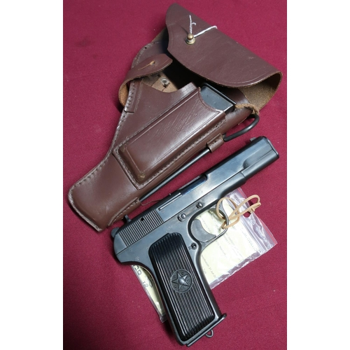 21 - Russian Tokaref TT33 semi auto 7.62 pistol complete with holster and spare magazine and cleaning rod...