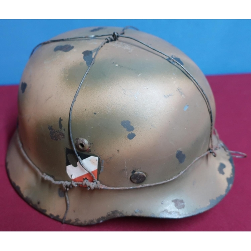 89 - German style steel helmet with leather liner and chin strap (possible reenactors/replica item)...