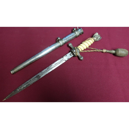 93 - German Kriegsmarine officers dagger, with 9 1/2 inch double fullered blade (pitted), naval crosspiec...