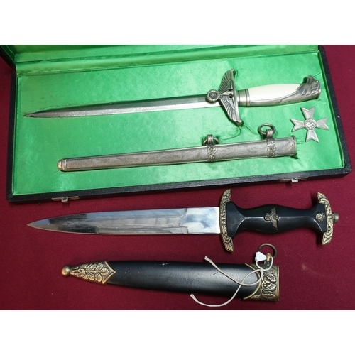 180 - Cased reproduction German officers dagger, blade marked F.W.H.O.LLER BERLIN with associated sheath, ...