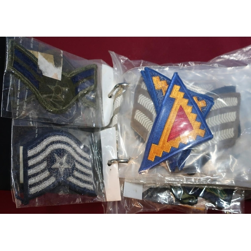 201 - Album of various assorted embroidered cloth military badges, British and American...