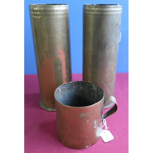 262 - Pair of French artillery shells, one with engraved trench art floral pattern detail dated 1917, the ...