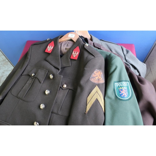 285 - Group of four continental military/police dress uniforms...