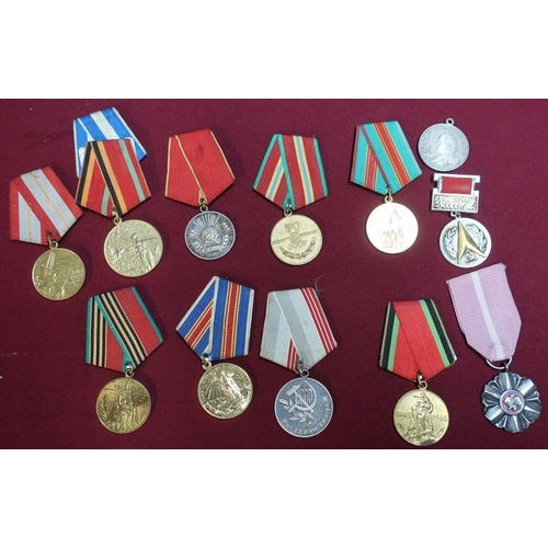 303 - Collection of various foreign medals including Polish long service medal, and a large selection of v...