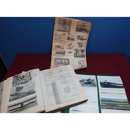 351 - Two albums of aviation interest, including various photographic postcards of aeroplane crashes, a sc...