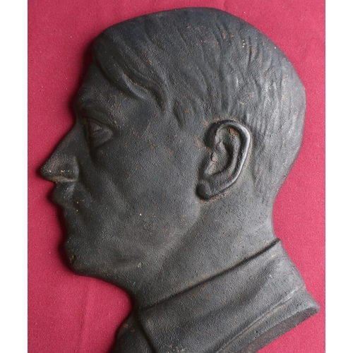 395 - Heavy cast metal wall plaque of Adolf Hitler (height 34cm)...
