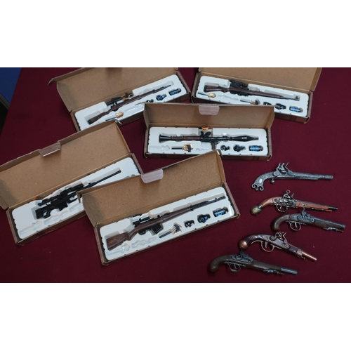 384 - Five boxed model service rifles and accessories, and a small selection of miniature reproduction fli...