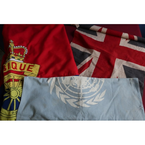 416 - Small mid 20th C British flag on staff, a UN flag, a large Royal Artillery flag, and another British...