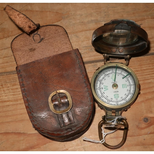 442 - Brass cased military style marching compass with leather pouch marked Stanley, London...