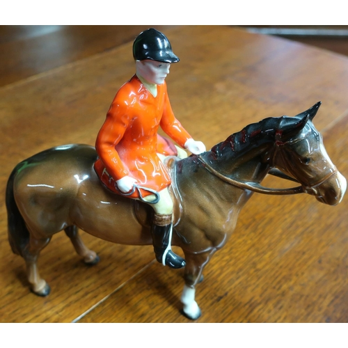 30 - Beswick figure of a huntsman on chestnut horse...