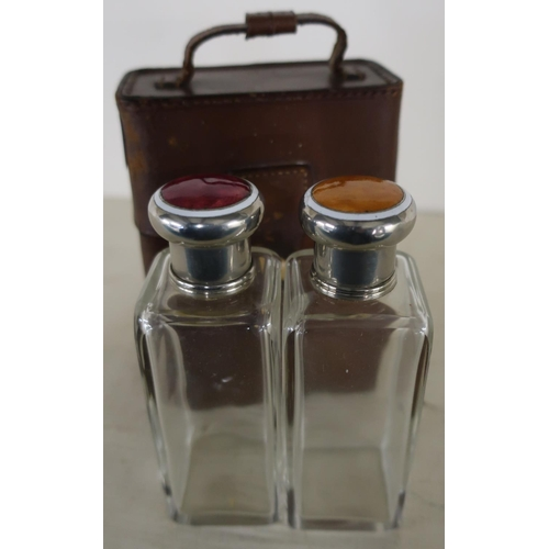 1 - c.1920's tan leather cased pair of travelling glass square form scent bottles with white metal and e...