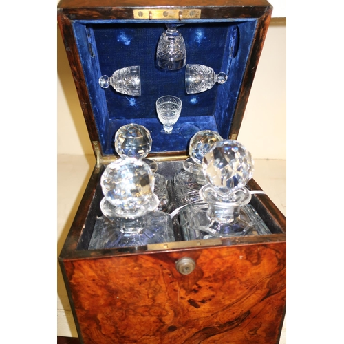18 - 19th C burr walnut cased decanter box with inset brass carry handles, the hinged top revealing fitte...