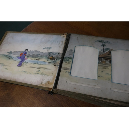 34 - 19th/20th C Victorian lacquered photograph album, the cover with black lacquered boards with inset M...