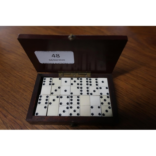 48 - Early 20th C mahogany rectangular box containing a collection of carved bone dominoes (9.5cm x 6cm x...