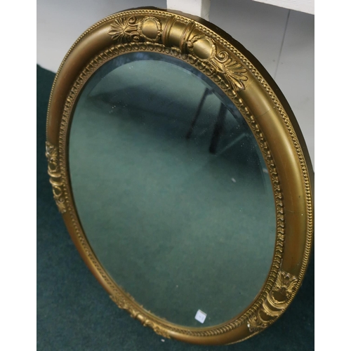 8 - Gilt framed bevelled edge oval wall mirror (83cm x 58cm)...
