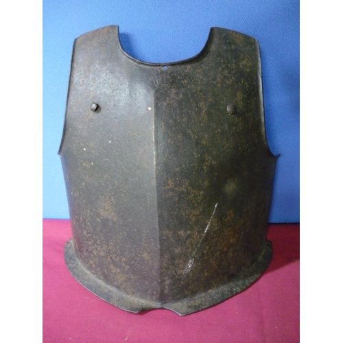 96 - Heavy steel breast plate with bullet shot mark, twin rivets and flange to the base, the front stampe...