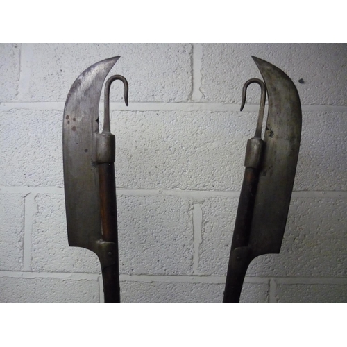 98 - Pair of Lochaber Axes on wooden shafts with butt spikes (overall length 182cm)...