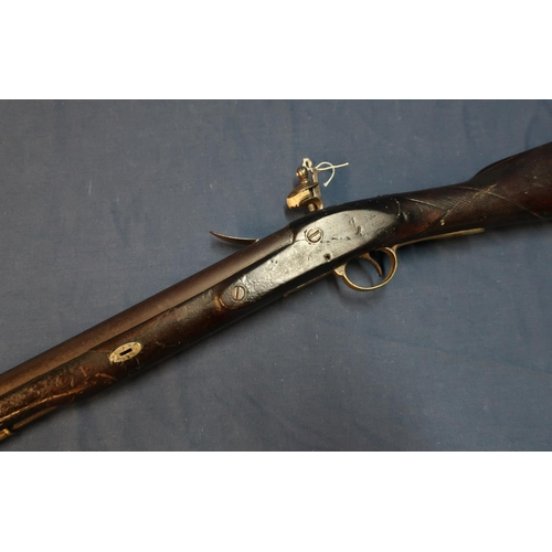 1 - Flintlock carbine, 16 inch barrel with worn proof marks, complete with swivel stirrup ramrod and bra...