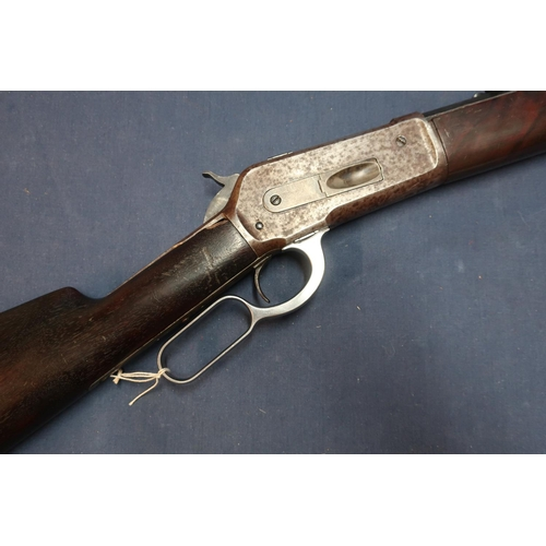 249 - 1886 model .40 Winchester rifle with 25 1/4 inch octagonal barrel with adjustable rear sights, seria...