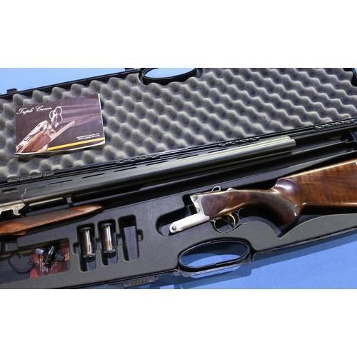 676 - Cased Akkar Triple Crown 20 bore triple barrel shotgun with 26 inch multi-choke barrels, single trig...