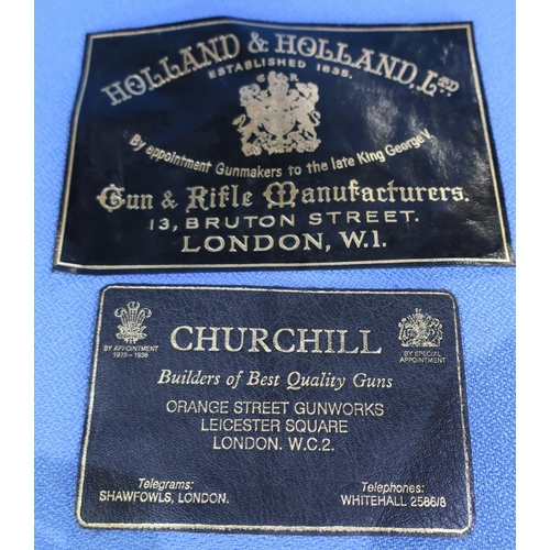 598 - Two leather trade labels for Holland & Holland and Churchill...