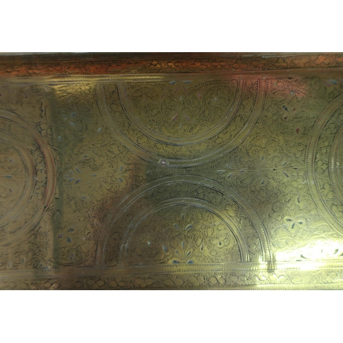 80 - Rectangular engraved eastern brass tray with twin carrying handles (74cm x 22.5cm)...