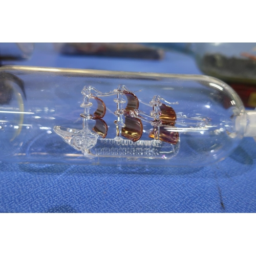 118 - Collection of four ship in bottle figures...