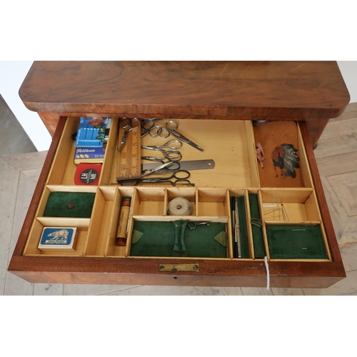 101 - Victorian walnut combination games and sewing table, with revolving fold-out top with inset chess bo...