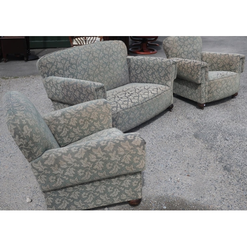 103 - 1930s three piece suite comprising of two seat drop end sofa and a pair of matching armchairs, on bu...