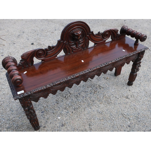 104 - Carved oak hall bench/window seat with elaborate carved detail and turned arm supports (121cm x 30cm...