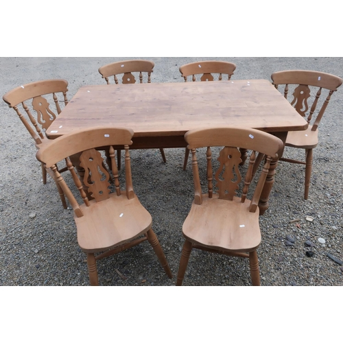 105 - Pine rectangular farmhouse style kitchen table on turned supports and a set of six beech farmhouse s...