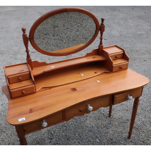 106 - Modern pine dressing table with raised mirror back and three drawers, on turned supports (width 111c...