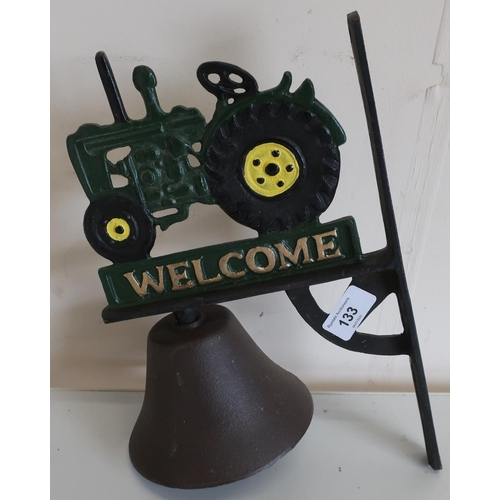 133 - Cast metal wall hanging bell with tractor figure...