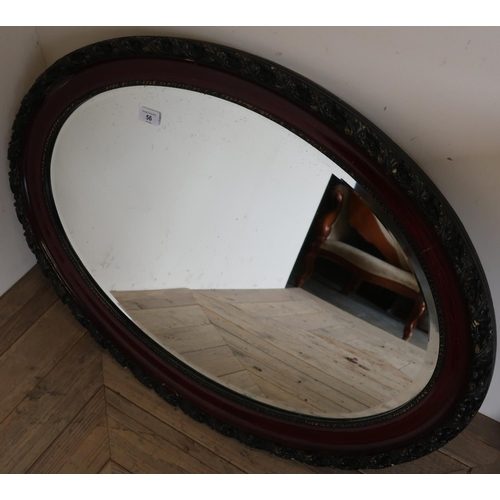 56 - Pair of oval bevel edged wall mirror with carved frames (84cm x 62cm) (2)...
