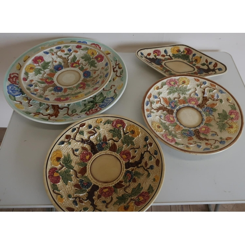 58 - Selection of five various assorted tree and floral pattern chargers and plates...